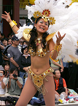 Foreigners are staying longer in Japan and contributing to the growing multiculturalism of the country, as seen in events such as the annual Asakusa carnival. | AP PHOTO
