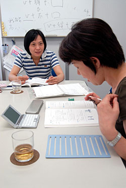 A student takes a Chinese language class at The World Languages Colleges in Tokyo (above); Akimasu Mitsuta (below), director of the Confucius Institute in Japan, says the usual emphasis on English teaching in Japan ignores the realities of doing business in modern Asia. | TONY McNICOL PHOTOs