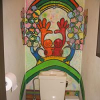 THE TOILET in Mina Mina restaurant looks like a normal toilet but is really of the jokaso variety. | AMY CHAVEZ PHOTO