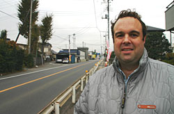 Australian Michael Laws stands at the spot of the accident in Saitama Prefecture that claimed the life of Patrick Alford. | DAVID McNEILL PHOTO