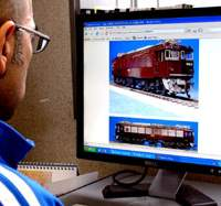 An Internet surfer reviews models trains on sale in online auctions.   YOSHIAKI MIURA PHOTO