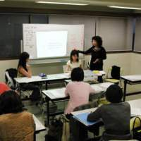 Kazuko Nagai (left), the founder of I'M Personal College, heads a classroom discussion (above) about plans for the graduation party (below) held on March 31. | YOKO HANI PHOTOS; YOSHIAKI MIURA PHOTO (below)