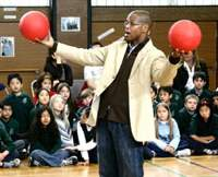 Motivational speaker Kevin Carroll uses red rubber balls to represent life ambition in a talk at the Tokyo International School. | ERIC PRIDEAUX PHOTO