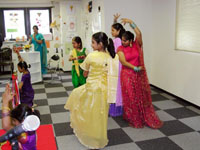 Students sing at the opening ceremony of the newly relocated India International School in Japan in Morishita, Koto Ward.