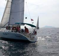Sunset off Phuket, Thailand, where this Yoshi Aoki-chartered multi-hull yacht was taking part in the King's Cup races in December 2004, in which this Aoki-chartered sloop (above) is competing. | YOSHI AOKI PHOTOS
