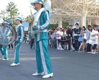 The Galactic Rangers brass band (top) entertains visitors waiting in lines at Tokyo Disneyland in Maihama, Chiba Prefecture (also above) | SATOKO KAWASAKI PHOTOS
