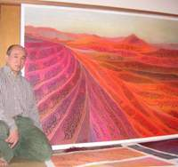 Arabic calligrapher Kouichi Honda beside his 1999 work 'Red Desert,' which was inspired by his years spent in the Middle East working for a Tokyo-based surveying company, and which features quotations from the Koran executed in four different styles of Arabic script. | TOMOKO OTAKE PHOTOS