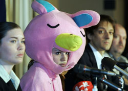 Nova teacher Kristen Moon, dressed as the corporation's once-ubiquitous rabbit mascot, speaks at the Foreign Correspondents' Club of Japan last week in Tokyo. | AP PHOTO