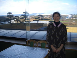 Chinami Seto (top), who prepares the menu at the largest Yamagishi commune, stands in the kitchen overlooking the To yosato 'jikkenchi' grounds in Mie Prefecture. In other scenes from Toyosato, the Yamagishi high school 'taiko' drumming group gives a spirited performance and commune members pound rice into 'mochi' for New Year's Day. | JOHN SPIRI PHOTOS