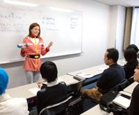 Cosplish teacher Mimmi Schwalbe, costumed as Sayla Mass from the 'Gundam' anime, gives a lesson during a Feb. 24 free trial at the school in Tokyo's Akihabara district. | YOSHIAKI MIURA PHOTO