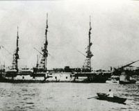 The 79-meter Turkish frigate Ertugrul in Istanbul (top) before its final voyage in 1890 when, after a 'friendship call' to Yokohama, it was dashed to pieces in a typhoon off the coast of Oshima Island (above), leading to the loss of most of its crew and its commander (center, in photo, below) who had posed with his officers for this now-water-damaged photo (below) that was washed ashore after the disaster. | PHOTOS (top and below) COURTESY OF KASHIMOTO-CHO TOWN OFFICE; WINIFRED BIRD PHOTO (above)