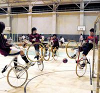 Cycleball players at the Tokyo Institute of Technology play football on two wheels at the university's gymnasium in Tokyo. | YOSHIAKI MIURA PHOTOS