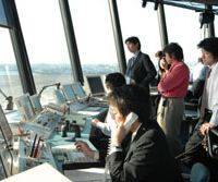 Traffic controllers survey their domain from the control tower at Haneda. | YOSHIAKI MIURA PHOTO