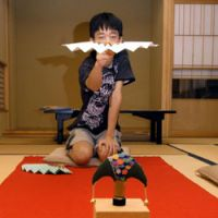 Perfect poise: Thirteen-year-old Kazunari Kikuchi gets ready to fling his fan in the traditional game of  tosenkyo.