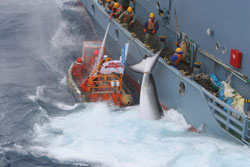 Whale of a crime: Activists are hosed down by whalers as they attempt to disrupt Japan's research whaling program. | COURTESY OF GREENPEACE JAPAN