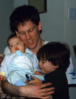 Better days: Canadian Murray Wood plays with his children, Taka and Mana, before their abduction.   COURTESY OF DAVID HEARN