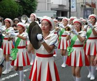 Marching to the beat: The Sogo Keibi Joshi Gijotai girls brass band, one of several brass bands at the Anjin Festival, particpates in the parade.   MIO YAMADA PHOTO