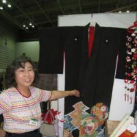 Elegance out of the attic: Katsuyo Kishi sells kimono at antique fairs for reduced prices, in the hope that more young people will wear them. | ERIKO ARITA PHOTO