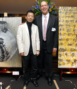 Art for food: Hitoshi Ohashi and Robert Tobin (left), organizers of the 'Silent Auction' event, pose for a photo at the auction's venue, a restaurant in Tokyo's Shibuya Ward. | YOSHIAKI MIURA PHOTOS