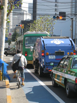 Easy rider: A peddle-pusher makes use of a bicycle lane in Tokyo's Hatagaya district, west of Shinjuku Station. | EDAN CORKILL PHOTO