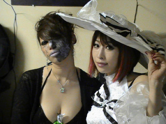 All dressed up with something to show: Artists Rukia Isono and Lucy pose for a picture backstage before their performance at Paint Your Teeth in Tokyo in April. | DAVID HOENIGMAN