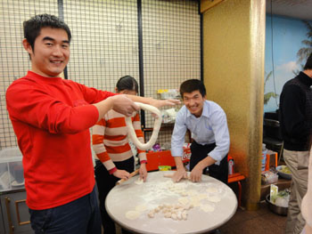 Taste of home: Chinese trainees make gyoza (Chinese-style meat dumplings) during a recent party at the shelter in Tokyo run by the Advocacy Network for Foreign Trainees. | COURTESY OF THE ADVOCACY NETWORK FOR FOREIGN TRAINEES