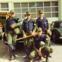 Lieber (back row, right) in riot gear poses with his fellow military policemen in Okinawa | COURTESY OF BRUCE LIEBER