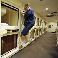 And so to bed: Your correspondent ascends to his capsule room at Rex Inn Kawasaki, where guests need pay only ¥3,000 a night (including pajamas). | YOSHIAKI MIURA PHOTO