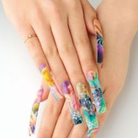 Beat that: First-place winner Megumi Motoi's 'Flat-Art' stick-on nails that scooped the All-Japan Nailist Championship category in which contestants use airbrushes to create their remarkable designs. | JAPAN NAILIST ASSOCIATION