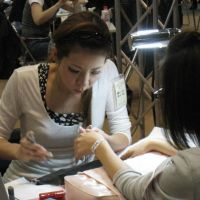 Nail-biting: A 5th World Nailist Championship contestant works on 'French sculpture' nails. | TOMOKO OTAKE