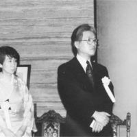Stage center: Tadao Sato and his wife, Hisako, at a ceremony in the mid 1990s. Sato has often been honored for his cultural exchange contributions, including with 1995's Mainichi Shuppan Culture Prize, 1996's Minister of Education, Culture, Sports, Science and Technology's Art Encouragement Prize, and 2010's Japan Foundation Award. | TADAO SATO PHOTO
