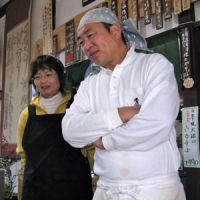Homegrown fare: Masahiro and Chieko Hosoi in their restaurant whose menu features their farm's organic rice and buckwheat. A former company worker, Masahiro now sells his rice via the Internet for 700 yen per kg compared with the 200 yen a kg that regular rice sells for wholesale.