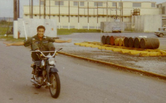 Carefree: Joe Sipala rides his motorcycle past a barrel of Agent Orange (the third one from the left) while serving in the military on Okinawa.   PHOTOS COURTESY OF JOE SIPALA