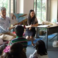 A picture is worth a thousand words: Nikolaos Zaimis, first counselor of the European Union's delegation to Japan, reads the Greek tale of 'Icarus' in Greek in front of families during a book-reading event at the EU office in Chiyoda Ward, Tokyo, on Saturday. | MAMI MARUKO PHOTO