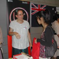 Educational options: Emma Parker, education project manager at the British Council, talks to a Japanese student taking part in an event July 26 at the Canadian Embassy in Tokyo to encourage Japanese to study abroad.