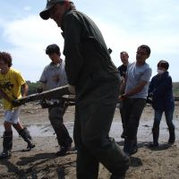 Rebirth of altruism: International volunteers clear debris in Iwate Prefecture in June. | JON MITCHELL PHOTO