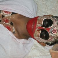 Sleeping god: A theyyam dancer takes a rest before entering a trance.