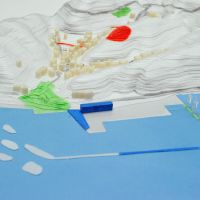 A drawing of the port at Ayukawahama reborn with tourism facilities including cafes.   ARCHIAID