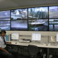 Nerve center: Tetsuya Shimazu, an official in the Tokyo Metropolitan Government's rivers department, mans the consoles in its emergency operations room. | TOMOKO OTAKE PHOTO