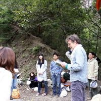 Gill reads haiku about the mountain to local cleanup volunteers.