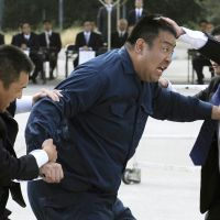 Take down: Officers foil a mock assassination attempt in a training exercise. | KYODO PHOTO