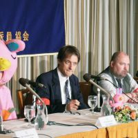 Labor pains: Louis Carlet, then deputy secretary of National General Workers Union Tokyo Nambu, is flanked by a Nova teacher dressed as the firm's iconic bunny and Nova union leader Bob Tench at the Foreign Correspondents' Club of Japan in Tokyo, just days after the nation's largest English conversation school chain sought court protection from creditors on Oct. 26, 2007. | KYODO PHOTO