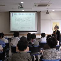 Stress fighters: Chikako Ishi, a therapist from Tokyo English Life Line, gives a lecture in September to NPO workers in Sendai on ways to cope with mental stress after a disaster. | COURTESY OF TELL