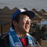 It's a start: Zensuke Oikawa hopes for another successful day at the Revival Market held in Minamisanriku, Miyagi Prefecture, in November. The only remnant of his sasa kamaboko shop in the town, which was destroyed by the March 11 tsunami, was a knife. | SKYE HOHMANN