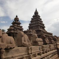 Marvels: The early 8th-century Shore Temple at Mahabalipuram, which features twin towers dedicated to Shiva and a courtyard flanked by a long wall topped with sculpted reclining bulls.