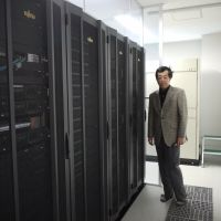 Electric dreams: University of Tokyo professor Hideaki Fujitani and the university's supercomputer, which is used just for the purpose of running simulations on potential drugs. | TOMOKO OTAKE