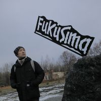 Yamamoto in the 30-km Chernobyl evacuation zone in Ukraine in December 2011 by a monument erected in April 2011 wishing an early end to the Fukushima radiation crisis. | JUN NAKASUJI
