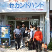 Cathy Hirano, director of the Second Hand charity organization, poses with workers at a shop run by the group in Takamatsu, Kagawa Prefecture. | COURTESY OF SECOND HAND
