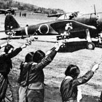Fatal flowers: High school girls in Chiran, Kagoshima Prefecture, wave sprigs of cherry blossom for Second Lt. Toshio Anazawa as he sets off on April 12, 1945, on one of the  kamikaze suicide missions carried out by so-called Oka (Cherry-blossom) pilots like him.