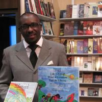 Positive image: Joel Assogba displays some of his multilingual children's books at a fair for Francophone authors in Ottawa last month. | COURTESY OF JOEL ASSOGBA